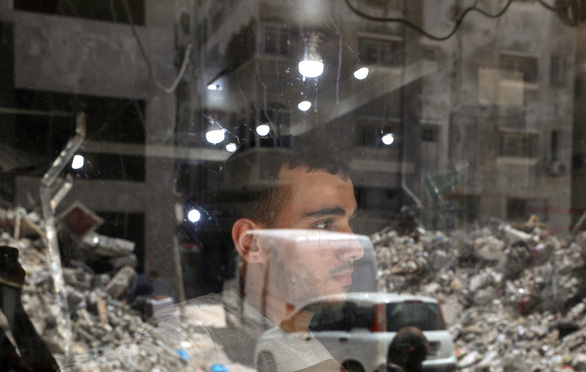WHO kêu gọi tạm thời ngừng bắn ở Dải Gaza để cứu dân - Ảnh 1.