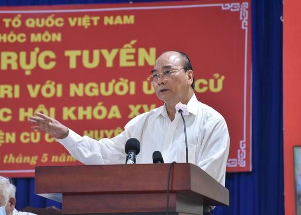 Chủ tịch nước Nguyễn Xuân Phúc: Để chiếc trực thăng mang tên TP.HCM cất cánh - Ảnh 2.