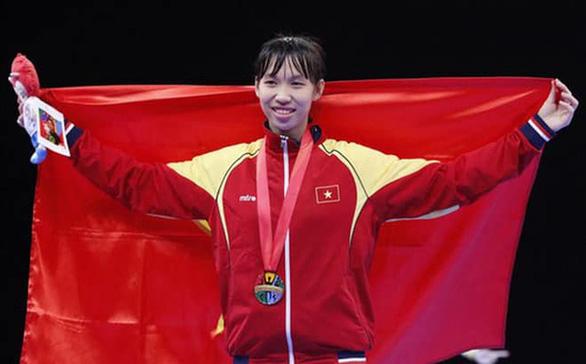Nữ võ sĩ taekwondo Trương Thị Kim Tuyền giành vé đến Olympic Tokyo 2021 - Ảnh 1.