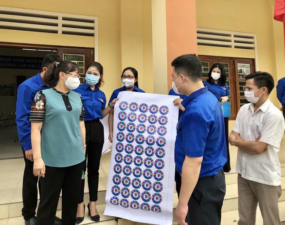 Hơn 1.000 đội thanh niên xung kích hỗ trợ bầu cử tại Lào Cai - Ảnh 1.