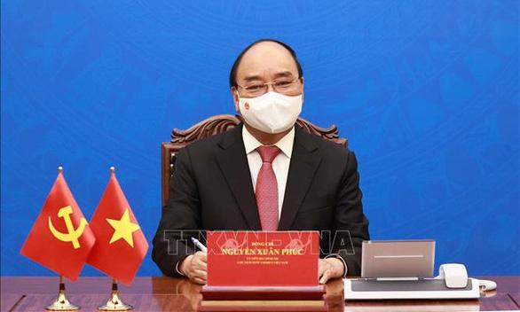Chủ tịch nước Nguyễn Xuân Phúc điện đàm với Chủ tịch Trung Quốc Tập Cận Bình - Ảnh 1.
