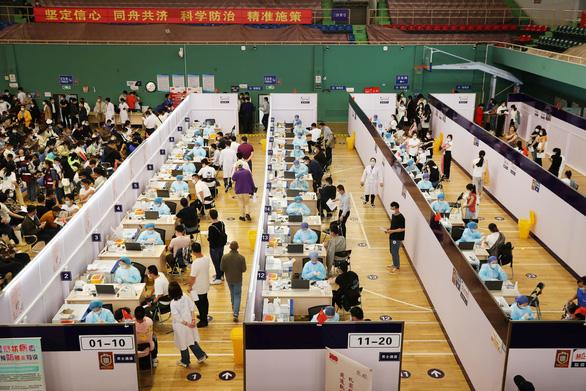 Trung Quốc trở thành nước đầu tiên phân phối nửa tỉ liều vắc xin COVID-19 - Ảnh 1.