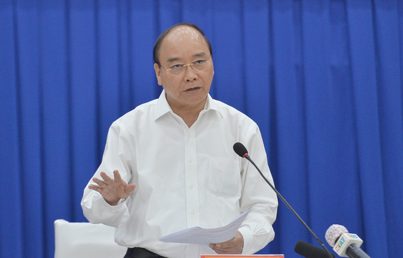 Chủ tịch nước Nguyễn Xuân Phúc kêu gọi cả nước chung tay đẩy lùi dịch bệnh - Ảnh 1.