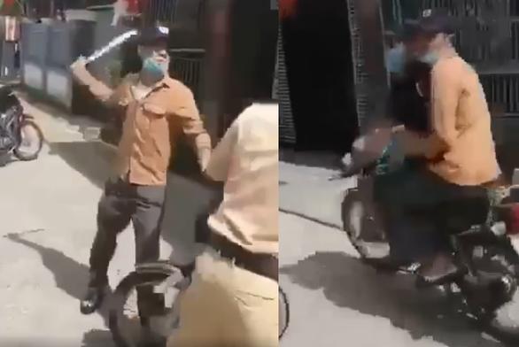 Xôn xao đoạn clip một thanh niên cầm dao uy hiếp cảnh sát giao thông - Ảnh 2.
