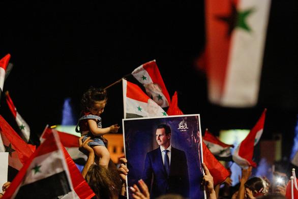 Tổng thống Syria tái đắc cử với 95% phiếu bầu, phương Tây lên án bầu cử thiếu tự do - Ảnh 1.