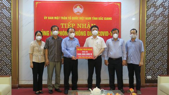EVNNPC ủng hộ 1 tỉ đồng cùng Bắc Giang, Bắc Ninh phòng chống COVID-19 - Ảnh 1.