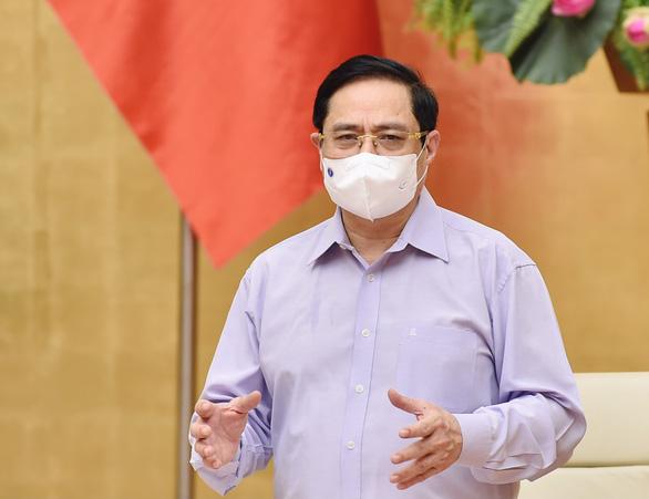 Thủ tướng Phạm Minh Chính: Phải tiếp cận mọi khả năng để mua vắc xin - Ảnh 1.