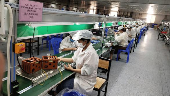 Nhiều doanh nghiệp ở Bắc Giang hoạt động trở lại - Ảnh 1.