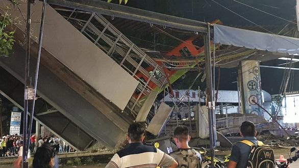 Kinh hoàng sập cầu vượt metro ở thủ đô Mexico, ít nhất 20 người chết - Ảnh 2.