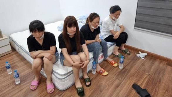 11 người Trung Quốc nhập cảnh trái phép đóng cửa cố thủ ở căn hộ chung cư tại Hà Nội - Ảnh 1.