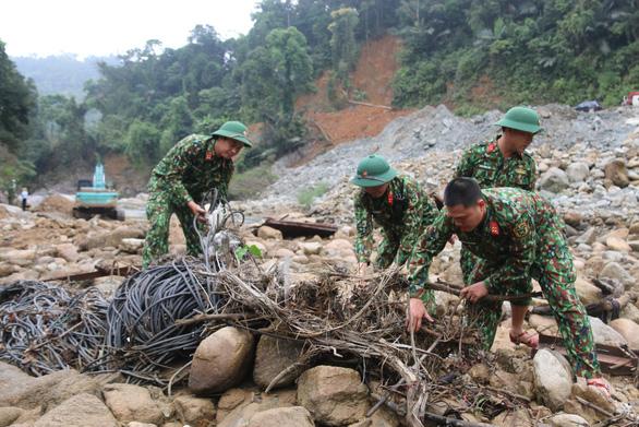 Dự kiến tháng 7 tiếp tục tìm kiếm 11 người mất tích ở thủy điện Rào Trăng 3 - Ảnh 1.