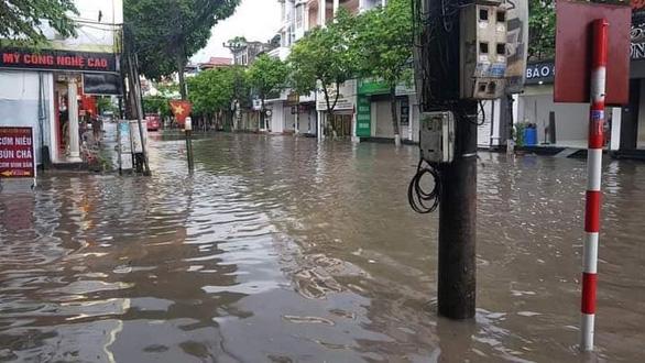 Miền Bắc mưa lớn, TP Thái Nguyên, Bắc Giang ngập gần nửa mét - Ảnh 1.