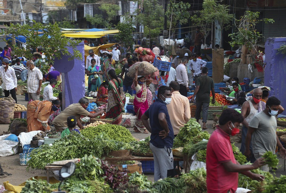 Dịch tăng cuồn cuộn, kinh tế Ấn Độ vẫn có thể ổn lại từ tháng 9? - Ảnh 2.