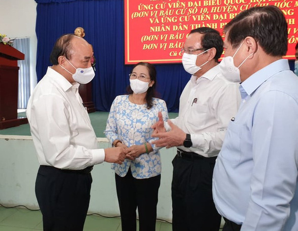 Chủ tịch nước Nguyễn Xuân Phúc làm việc tại Củ Chi - Ảnh 1.