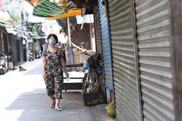 Chợ Phú Nhuận lại ngưng hoạt động, lấy mẫu xét nghiệm hơn 1.000 người - Ảnh 4.