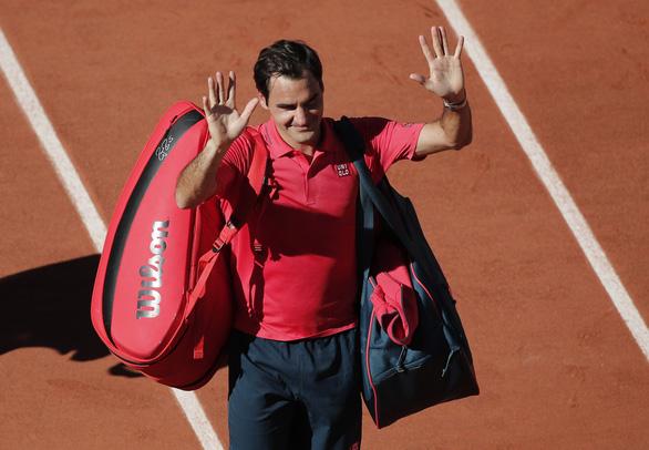 Tái xuất ở Grand Slam sau hơn 1 năm vắng bóng, Roger Federer thắng ấn tượng - Ảnh 1.