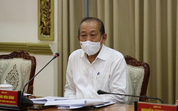 Phó thủ tướng Trương Hòa Bình: TP.HCM phải quyết tâm dập dịch trong 2 tuần - Ảnh 1.