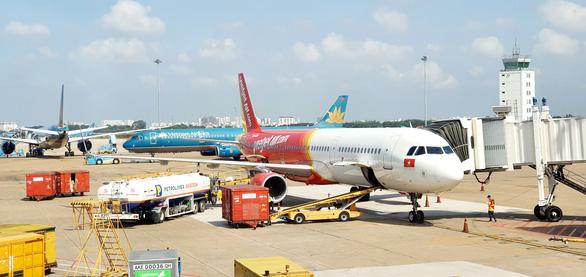Thêm hãng bay Việt Nam thử nghiệm hộ chiếu vắc xin để bay quốc tế - Ảnh 1.