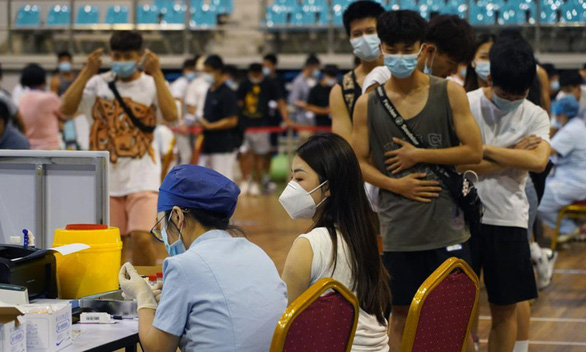 Trung Quốc phê duyệt vắc xin COVID-19 thứ 7, phân phối hơn 800 triệu liều - Ảnh 1.
