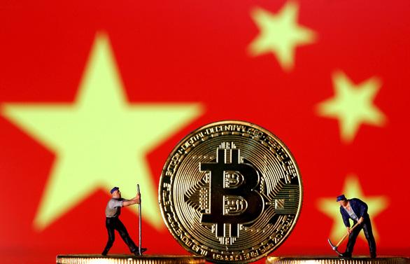Trung Quốc phá mạng lưới rửa tiền bằng tiền ảo, bắt 1.100 người - Ảnh 1.