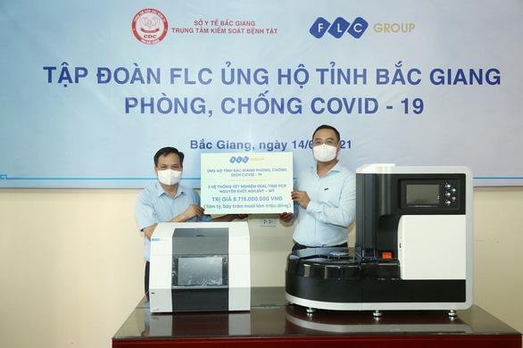 Tập đoàn FLC tặng Bắc Giang ba hệ thống xét nghiệm COVID-19 - Ảnh 1.