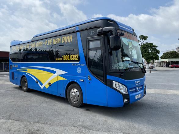 Tin sáng 13-10: Đề nghị cho xe khách từ Hà Nội, TP.HCM chạy lại; vắc xin trẻ em sắp về - Ảnh 2.