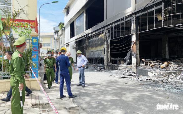 Vụ cháy phòng trà làm 6 người tử vong: Có thể do chập điện - Ảnh 2.