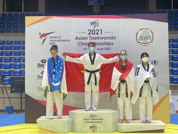Võ sĩ Kim Tuyền giành HCV Giải taekwondo vô địch châu Á 2021 - Ảnh 2.