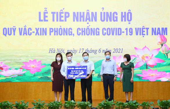 Quỹ vắc xin phòng, chống COVID-19 nhận thêm ủng hộ từ Bộ Lao động, thương binh và xã hội - Ảnh 1.