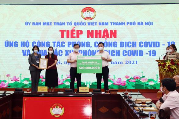 Traphaco tặng 500 triệu đồng mua vắc xin ngừa COVID-19 cho Hà Nội - Ảnh 1.