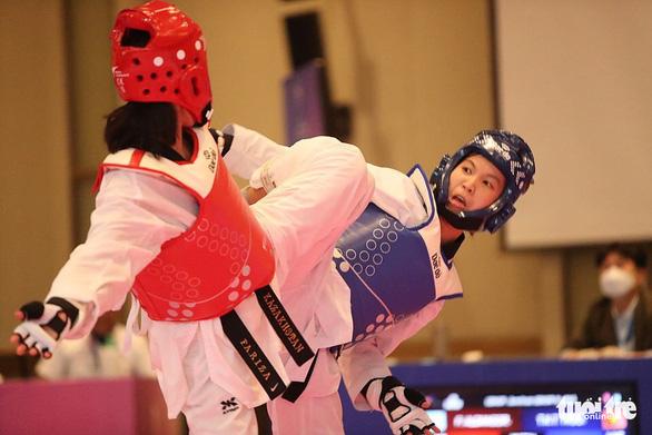 Võ sĩ Kim Tuyền giành HCV Giải taekwondo vô địch châu Á 2021 - Ảnh 1.