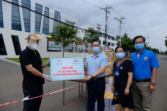 TP.HCM hỗ trợ gần 7.000 công nhân, lao động bị ảnh hưởng bởi dịch bệnh - Ảnh 1.