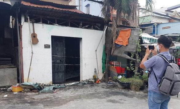 Cháy nhà Tân Phú lúc nửa đêm, vợ chết, 2 cha con bị thương - Ảnh 2.