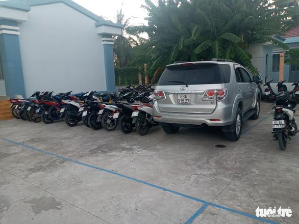 Dùng xe tải chở xe cọp từ TP.HCM đến Tiền Giang để đua xe trái phép - Ảnh 2.