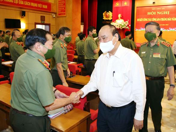 Chủ tịch nước Nguyễn Xuân Phúc: Nâng cao chất lượng điều tra, khám phá tội phạm - Ảnh 1.