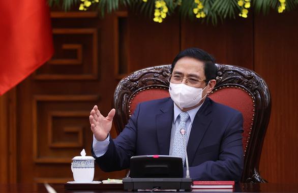 Thủ tướng Phạm Minh Chính: Chống cạnh tranh giữa tư nhân và Nhà nước trong việc mua vắc xin - Ảnh 1.