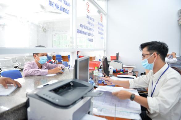 Văn phòng đăng ký đất đai TP.HCM và các chi nhánh ngưng nhận hồ sơ trực tiếp - Ảnh 1.