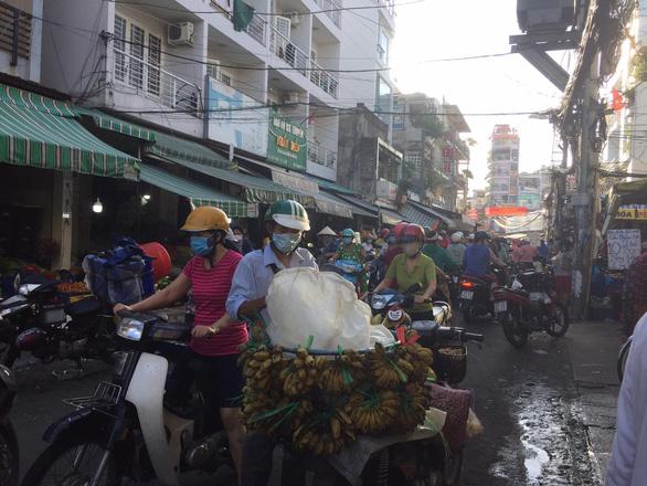 TP.HCM khẩn tìm người đã đến chợ đầu mối Hóc Môn, Bình Điền và chợ Sơn Kỳ - Ảnh 1.