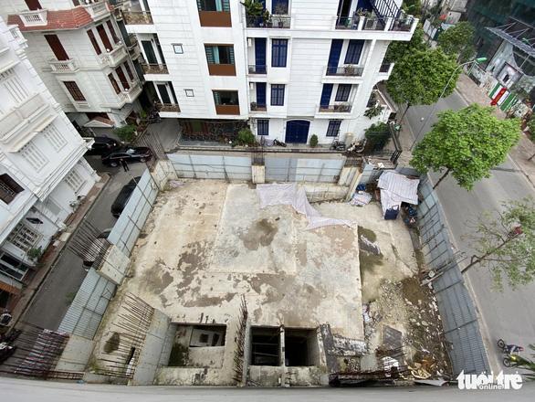 Vụ 'nhà phố 4 tầng hầm': Bộ Xây dựng yêu cầu Hà Nội báo cáo trước ngày 25-6 - Ảnh 1.