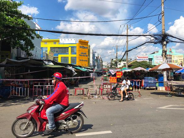 TP.HCM: Thêm 25 ca COVID-19 liên quan chợ Bình Điền và chợ Sơn Kỳ - Ảnh 1.
