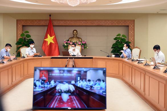 Phó thủ tướng: Đồng Nai cần dùng công nghệ để kiểm soát dòng người di chuyển - Ảnh 1.