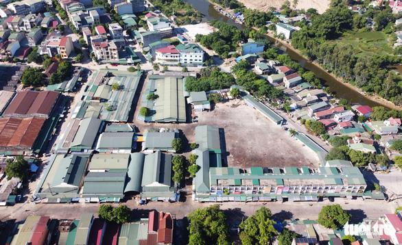 Chuỗi ca COVID-19 chợ đầu mối TP Vinh lan ra các huyện ở Nghệ An - Ảnh 1.