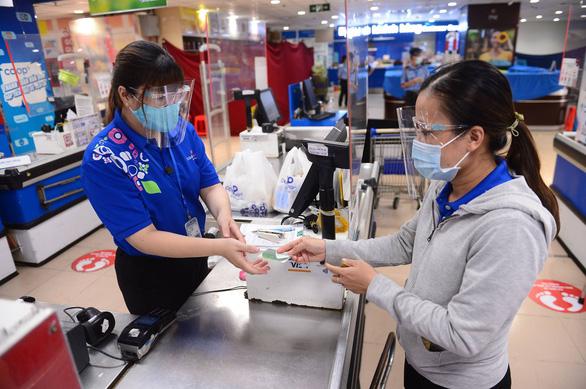 Vietcombank triển khai nhiều sản phẩm thúc đẩy thanh toán không dùng tiền mặt - Ảnh 1.