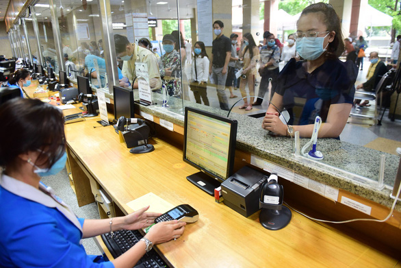Vietcombank triển khai nhiều sản phẩm thúc đẩy thanh toán không dùng tiền mặt - Ảnh 2.