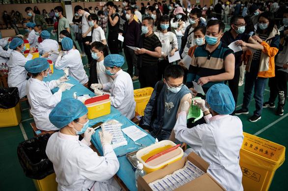 Các nước tăng tốc tiêm vắc xin COVID-19 ra sao? - Ảnh 6.