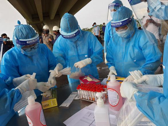Thêm 5 công nhân thuộc dự án cao tốc Trung Lương - Mỹ Thuận nghi mắc COVID-19 - Ảnh 1.