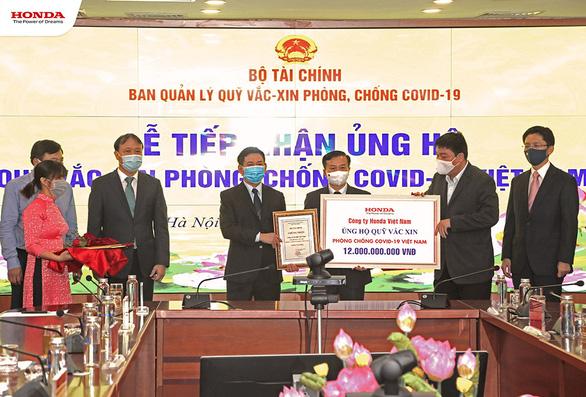 Honda Việt Nam ủng hộ 12 tỉ đồng vào Quỹ vắc xin phòng COVID-19 - Ảnh 1.
