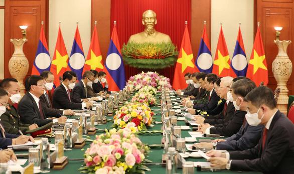 Tổng bí thư, Chủ tịch nước Lào bắt đầu thăm hữu nghị chính thức Việt Nam - Ảnh 4.