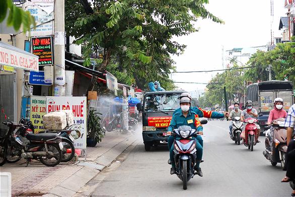 Bệnh nhân COVID-19 rời Thủ Đức về nhà ở Tân Phú đã được đưa trở lại nơi điều trị - Ảnh 1.