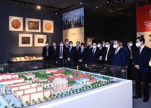 Chủ tịch nước Nguyễn Xuân Phúc hội kiến Tổng bí thư, Chủ tịch nước Lào Thongloun Sisoulith - Ảnh 2.